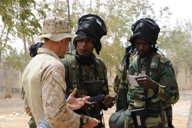 A United States Marine adviser speaks with the leaders of an African special forces unit during a training exercise. (Master Sgt. Jeremiah Erickson/U.S. Air Force Photo)